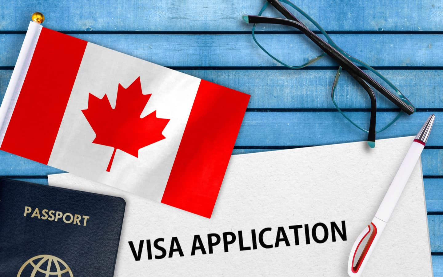 Visa application with Canadian flag and Canadian passport