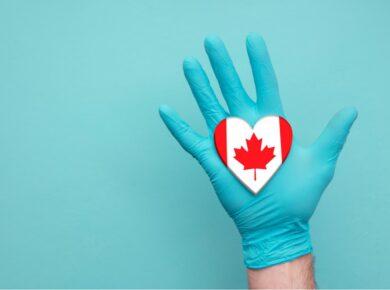 Nurse hand holding a Canadian heart
